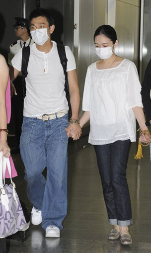 Masked Life: Andy Lau and Carol Zhu are the ultimate mystery couple.